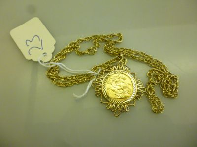 GOLD SOVERIGN AND 9CT GOLD CHAIN 27.5 GR